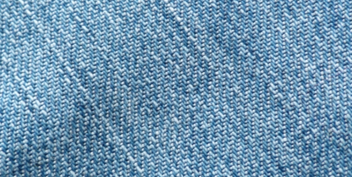 Enzymes for finishing cotton fabrics